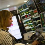 Ein Verkäuferin an der Londoner Börse: Die Miene dürfte doch eigentlich freundlicher sein.
