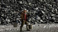 Ein chinesischer Arbeiterin einer Mine nahe Datong, im Norden Chinas. Peking will den Ausfuhrzoll für Kohle drastisch senken.