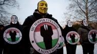Mitglieder von Anonymous auf einer Demonstration
