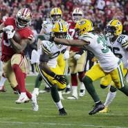 Raheem Mostert (Mitte) von den San Francisco 49ers auf dem Weg zum Touchdown gegen die Green Bay Packers beim NFL-Halbfinale in Santa Clara