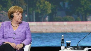 Angela Merkel and Vladimir Putin attend the St. Petersburg Intern