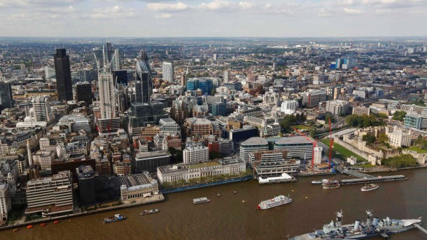 The City of London and the Swiss RE (known as the Gherkin) building and HMS Belfast are seen from the 69th floor of the Shard during its inauguration in London