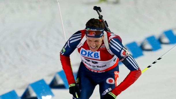 Burke of the U.S. reacts after crossing the finish line in the men's 20 km individual race during the International Biathlon Union World Championships in Nove Mesto