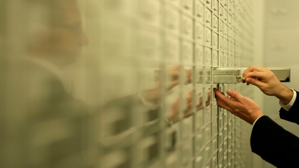 An Employee checks safe boxes before the public opening of the safe room of the Zuercher Kantonalbank in Zurich