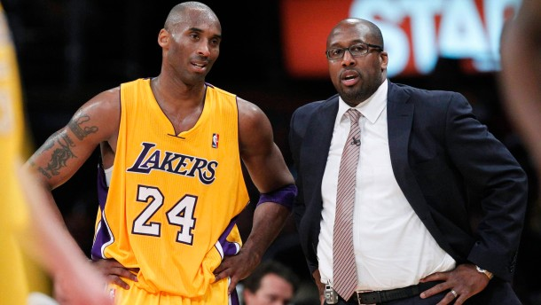 File photo of Los Angeles Lakers' Bryant chatting to coach Brown during their NBA Western Conference playoff against Denver Nuggets in Los Angeles