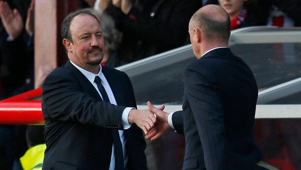 Chelsea's interim manager Benitez shakes hands with Brentford manager Rosler after their FA Cup fourth round soccer match in London