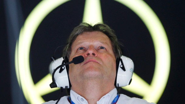 File picture shows Haug, Vice-President of Mercedes-Benz Motorsport, as he watches the first practice session of the Australian F1 Grand Prix in Melbourne
