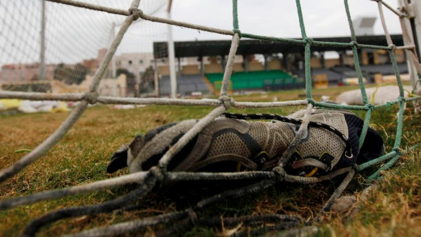 A shoe is seen inside the goal net one day after soccer supporters clashed at the Port Said stadium