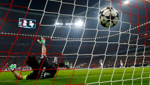 Juventus' goalkeeper Buffon recieves a goal by Bayern Munich's Alaba during their Champions League quarter-final first leg soccer match in Munich