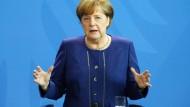 Merkel bittet zum Gruppenbild