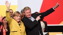 Image-Suche im Merkel-Dilemma