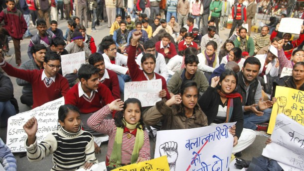Indian female activists participate in a protest against the rece