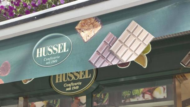 Douglas verkauft Süßwarenkette Hussel
