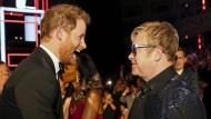 Zwei für Amsterdam: Auch Prinz Harry (links) und Elton John fahren nächste Woche zur Welt-Aidskonferenz.