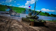 A T-72B combat tank crosses a pontoon bridge on July 21, 2017, at the Sergeyevsky troop training ground in the eastern military district.