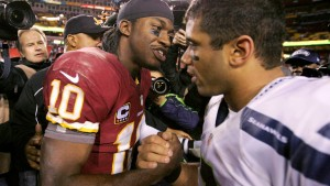 Seahawks quarterback Russell Wilson congratulated by Redskins quarterback Robert Griffin III, following their NFL NFC wildcard playoff game in Landover