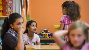 Kinder von Einwanderern holen bei Bildung auf
