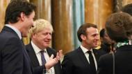 Justin Trudeau unterhält sich im Buckingham-Palast mit Boris Johnson, Emmanuel Macron und der britischen Prinzessin Anne.