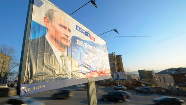 A presidential campaign poster for Russia's Prime Minister Vladimir Putin is on display in the far eastern city of Vladivostok