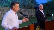 Nicht ganz einer Meinung: Santos (links) und Pence am Sonntag in Cartagena