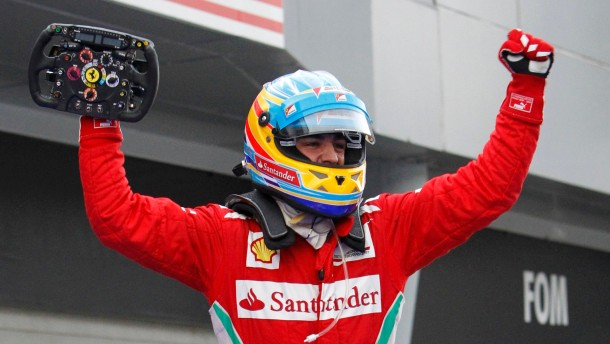 Ferrari Formula One driver Alonso celebrates his victory in the Malaysian F1 Grand Prix at Sepang International Circuit