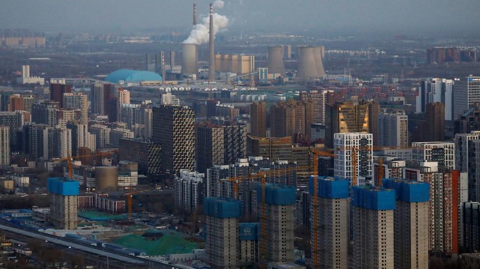 Chinas Wirtschaft brummt wieder: In der Nähe von Pekings Businesszentrum entstehen neue Wohnhäuser.