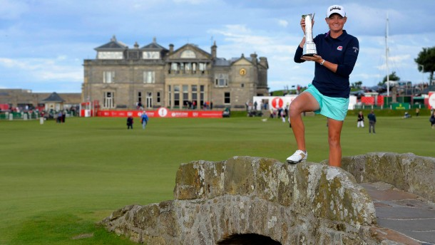 Lewis of the U.S. poses with the trophy after winning the Women's British Open golf championship at St Andrews in Scotland