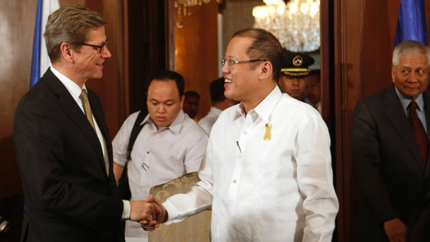 Philippine President Aquino shakes hands with German Foreign Minister Westerwelle during a meeting in Manila