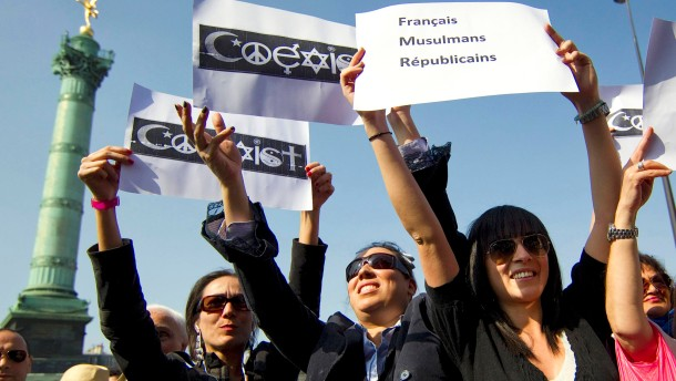 Demonstrators take part in silent White march calling for religious unity in France.