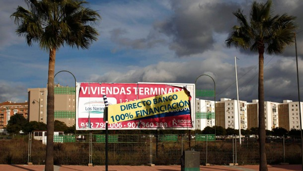 A banner advertising houses for sale is seen in Estepona, southern Spain