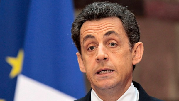 French President Nicolas Sarkozy adress his New Year speech to th