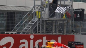 Red Bull Formula One driver Vettel takes the chequered flag to win the Indian F1 Grand Prix at the Buddh International Circuit in Greater Noida