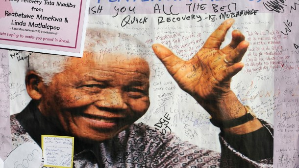 A poster of Nelson Mandela is filled with get well messages outside the Medi-Clinic Heart Hospital, where he is being treated at, in Pretoria