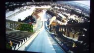 Wilde Fahrt im Skisprung-Simulator