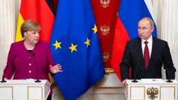 Merkel und Putin verteidigen Iran-Atomabkommen