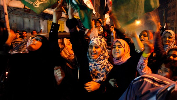 Palestinians celebrate what they say is a victory over Israel after an eight-day conflict in Gaza City