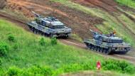 Nato-Staaten verringern Militärausgaben