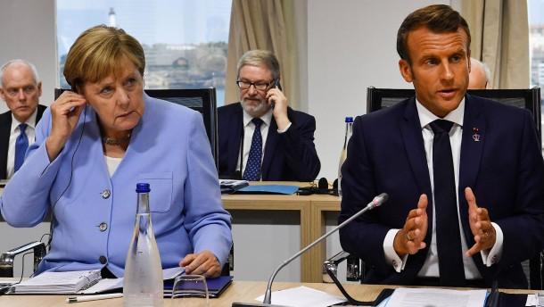 Das Tauziehen zwischen Merkel und Macron