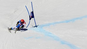 Switzerland's Cuche speeds down the slope during the men's Alpine Skiing World Cup Super G race in Crans-Montana