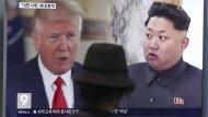 Donald Trump, Kim Jong-un im August auf einem Fernsehschirm in Seoul