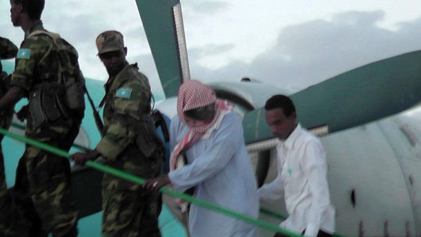 Sheikh Hassan Dahir Aweys, one of Somalia's most prominent Islamist rebel commanders, who was arrested on Wednesday, is escorted at Adado airstrip