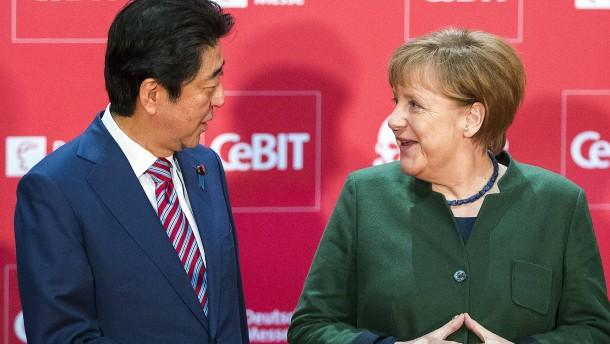 Merkel und Abe wollen für Freihandel kämpfen