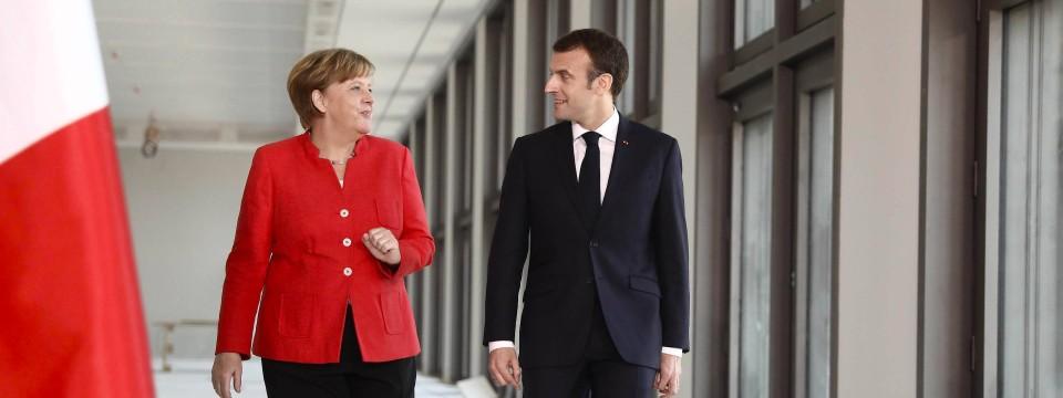 Bundeskanzlerin Angela Merkel (CDU) und der französische Präsident Emmanuel Macron am Donnerstag auf der Baustelle des Humboldt Forums im Berliner Stadtschloss