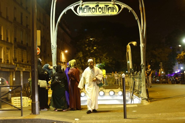 Lahcen walks past a metro station in Paris