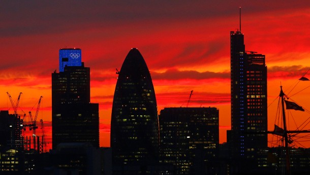 Sunset is seen behind the city of London