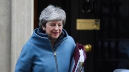 May bedauert Austritt von drei Tory-Abgeordneten