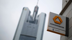 A sign with the logo of Germany's Commerzbank is pictured next to the bank's headquarters in Frankfurt