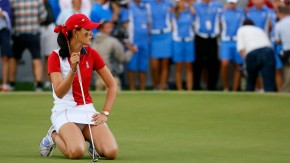 Wie of Team USA slumps to her knees as Team Europe looks on after missing a birdie putt on the 18th green in the singles matches at the 2013 Solheim Cup at Colorado Golf Club in Parker, Colorado