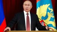 Ganz zufrieden: Wladimir Putin am Donnerstag in Moskau.