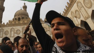 Egyptian protesters shout slogans against Israel's ongoing military operation in Gaza Strip, in old Cairo